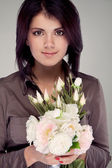 Portrait of a girl with a bouquet of flowers (retro) — Stock Photo