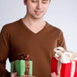 Happy guy holding a lot of gifts — Stock Photo #34548369