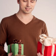 Happy guy holding a lot of gifts (retro) — Stock Photo #34549181