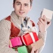 Young man surprised gifts — Stock Photo