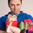 Portrait of a man holding a lot of gifts in the hands of (retro) — Stock Photo #36818649
