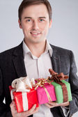 Portrait of a man in a suit with gifts — Stock Photo