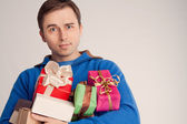 Portrait of a surprised man with gifts (retro) — Stock Photo