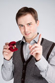 Portrait of a man holding a ring and showing thumbs up — Stock Photo