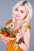 Girl in a dress holding a basket with voschami — Stock Photo