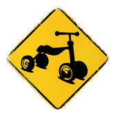 Warning road sign with a kids bike — Vector de stock