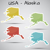 Stickers in form of Alaska state, USA — Stock Vector