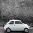 A Fiat 500  on the street of Pisa — Stock Photo #49578365