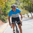 Man riding bicycle — Stock Photo