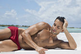 Man sunbathing on the beach — Foto Stock