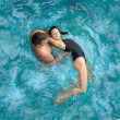 Couple at pool having a theraphie — Stock Photo