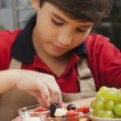 Boy making fruit salad — Stock Photo #22114739