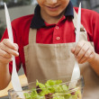 Boy making fruit salad — Stock Photo #22115005