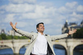 Man smiling with his arm outstretched — Stock Photo