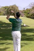 Rear view of a man playing golf — Stock Photo