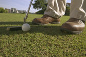 Low section view of a person playing golf — Stock Photo