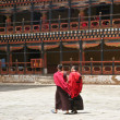 Monks debating at Rinpung Dzong in Paro, Bhutan - Stok fotoraf