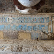 Ancient Egyptian hieroglyphs and carved paintings — Stock Photo