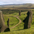 Several moai at Rano Raraku, Easter Island - Stock Photo