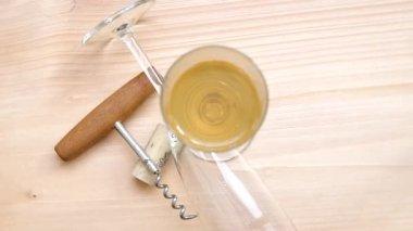 Corkscrew, cork and glass of white wine — Stock Video