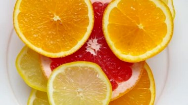 Sliced grapefruit, orange and lemon — Stockvideo