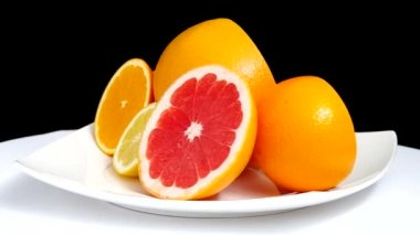 Sliced grapefruit, orange and lemon — 图库视频影像