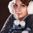 Girl froze and holds toy - Stock Photo
