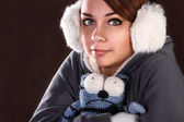 Girl froze and holds toy — Stock Photo
