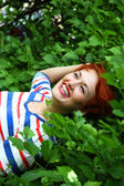 Red happy beautiful girl face smile — Стоковое фото
