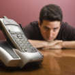 Man bored waiting for the phone to ring — Stock Photo #18879141