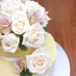 Cream and latte roses on a beautiful cake — Stock Photo