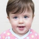 Beautiful baby girl in pyjamas — Stock Photo