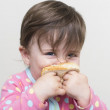 Messy little girl eating a sandiwch — Stock Photo #18949881