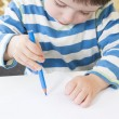 Toddler drawing with a poor pencil grip — Stock Photo #18961065
