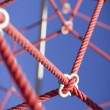 Rope linkages out outdoor play equipment — Stock Photo