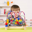 Toddler playing with a challenging toy — Stock Photo
