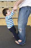 Toddler walks on Dad's feet — Stock Photo