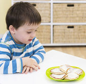 Young boy waiting to eat pikelets — Stock Photo