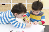 Twin boys drawing together — Stock Photo
