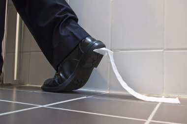 Toilet paper stuck to business shoe