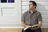Man looks side while reading the bible — Stock Photo
