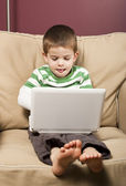 Young boy using a netbook computer — Stock Photo