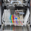 Packed dishwasher of clean dishes — Stock Photo