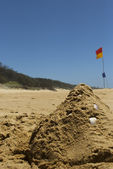 Sand castle on an Aussie beach — Stock Photo
