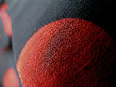 Macro detail of red and black cloth — Stock Photo