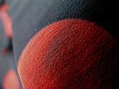 Kırmızı ve siyah kumaş makro detay — Stok fotoğraf