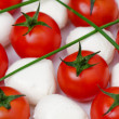 Cherry tomatoes with mozzarella — Stock Photo