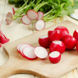 Radishes on cutting board — Stock Photo