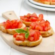 Bruschettwith tomato — Stock Photo #27499905