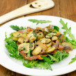 Rocket salad with smoked ham and mushrooms — Stock Photo #39377511